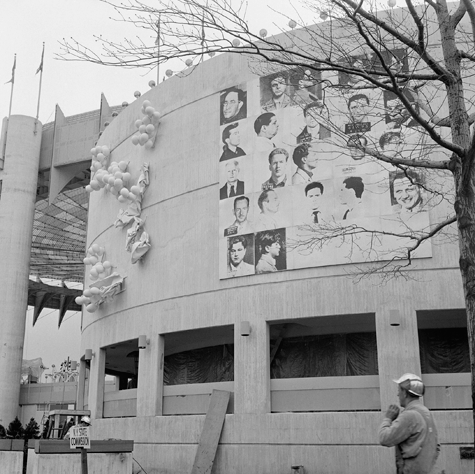 Andy Warhol, Thirteen Most Wanted Men, silkscreen on canvas, 20 x 20 ft. Installed on the exterior of the New York State Pavilion. © 2014 The Andy Warhol Foundation for the Visual Arts, Inc. / Artists Rights Society (ARS), New York
