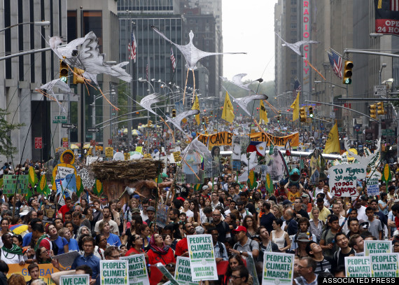 Demonstrators make their way down Sixth Avenue in New York during the People's Climate March Sunday, Sept. 21, 2014.  The march, along with similar gatherings scheduled in other cities worldwide, comes two days before the United Nations Climate Summit, where more than 120 world leaders will convene for a meeting aimed at galvanizing political will for a new global climate treaty by the end of 2015. (AP Photo/Jason DeCrow)